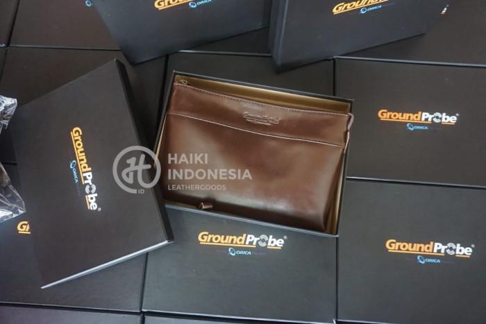 Contoh Barang Merchandise tas clutch kulit asli